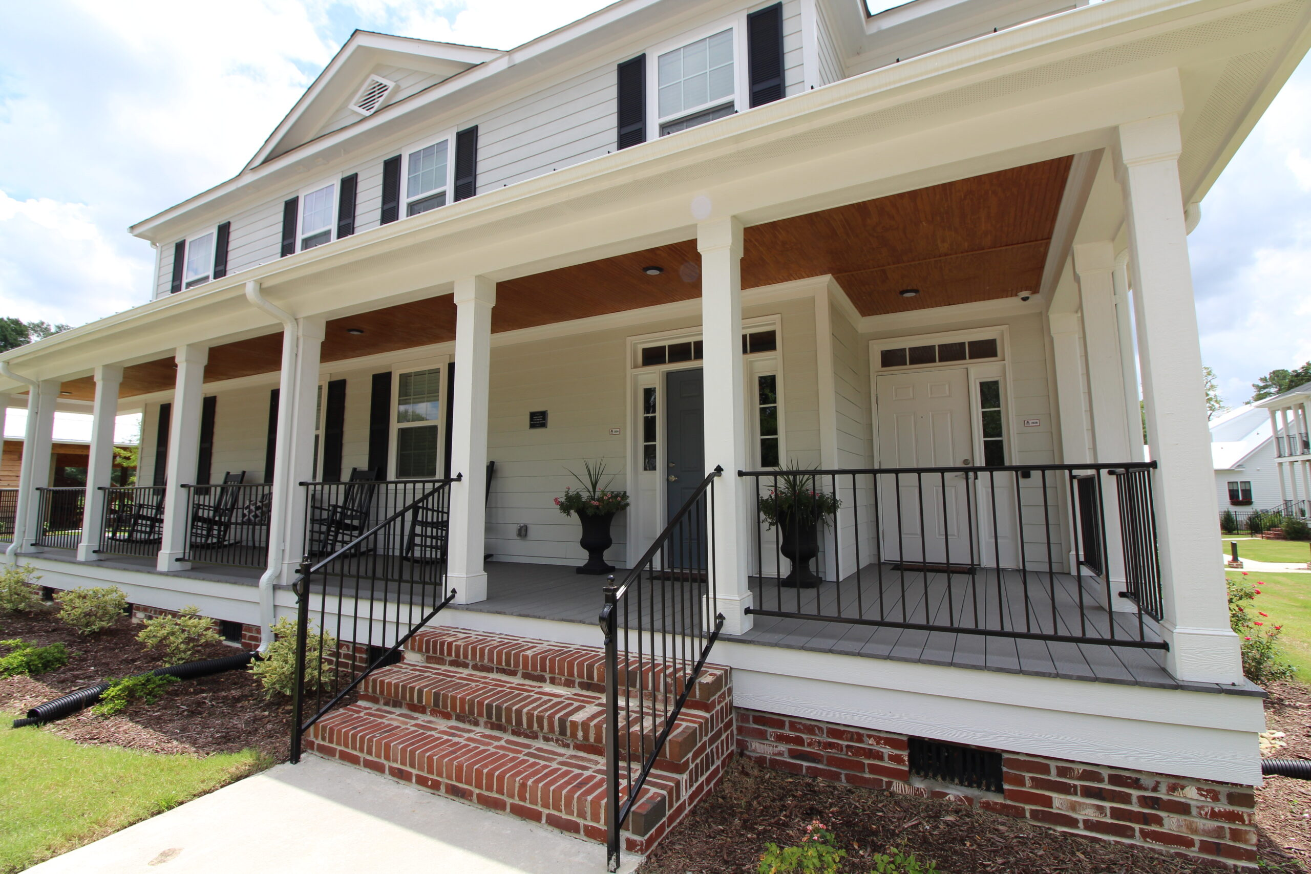 Two story house with a wrap around porch