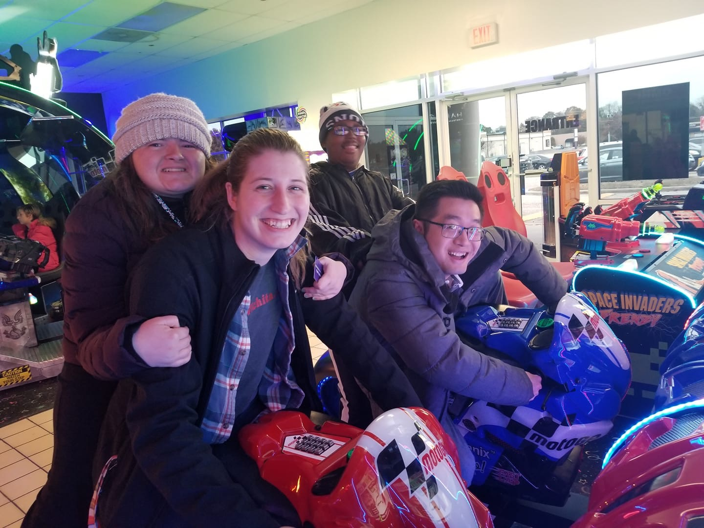 Group of people in arcade